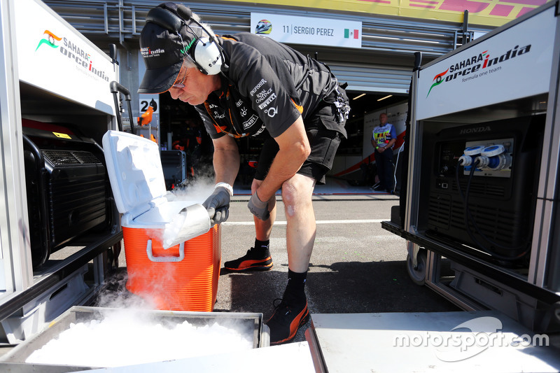 Sahara Force India F1 Team mechanic with dry ice