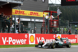 Race winner Lewis Hamilton, Mercedes AMG F1 W06 celebrates as he takes the chequered flag at the end of the race