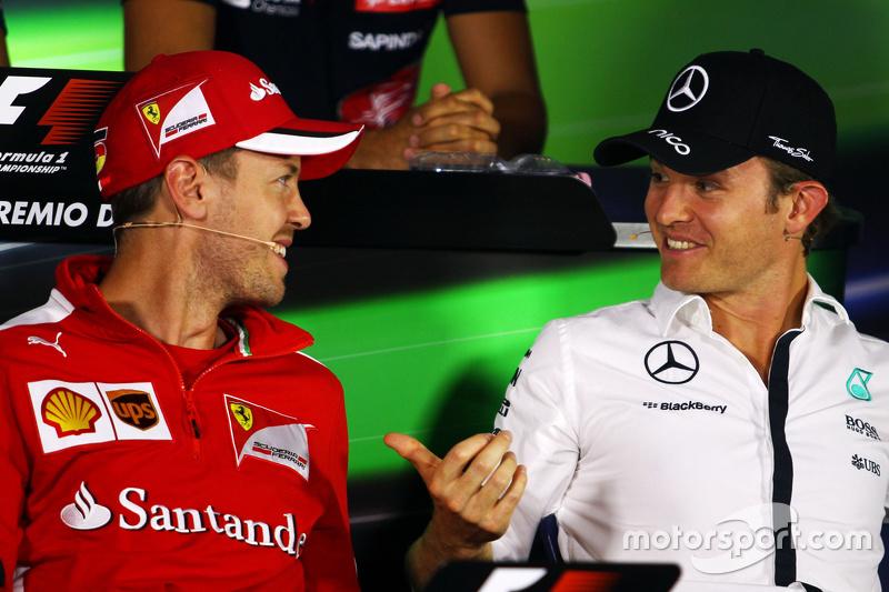 Sebastian Vettel, Ferrari, und Nico Rosberg, Mercedes AMG F1