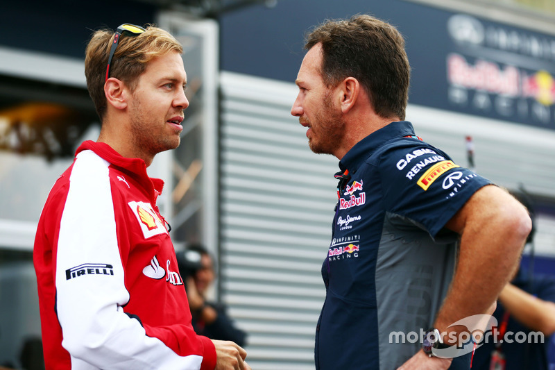Sebastian Vettel, Ferrari with Christian Horner, Red Bull Racing Team Principal