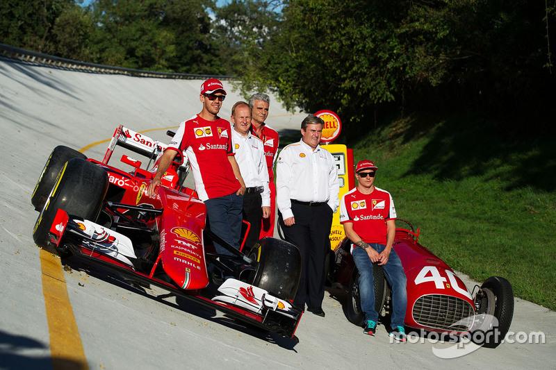 The Ferrari SF15-T and Ferrari 166 F1 cars on the Monza banking with Sebastian Vettel, Ferrari, John