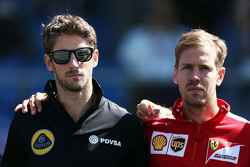 Romain Grosjean, Lotus F1 Team and Sebastian Vettel, Ferrari