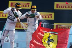 (L to R): Race winner Lewis Hamilton, Mercedes AMG F1 and third placed Felipe Massa, Williams celebrate on the podium