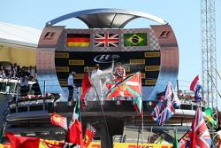 (L to R): Race winner Lewis Hamilton, Mercedes AMG F1 and second placed Sebastian Vettel, Ferrari celebrate on the podium