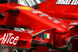 Scuderia Ferrari, with a different tone of red in their paint scheme