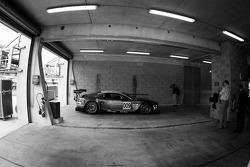 A lonely Aston Martin DBR9 in the Aston Martin Racing garage area