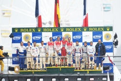 LMP1 podium: overall winners Marco Werner, Frank Biela, Emanuele pirro, second place pedro Lamy, Sté