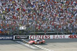 Carl Edwards takes the checkered flag