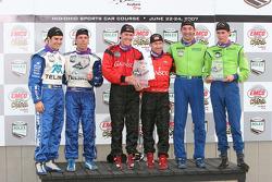 Podium: winners Alex Gurney and Jon Fogarty, second place Scott Pruett and Memo Rojas, third place Colin Braun and Max Papis