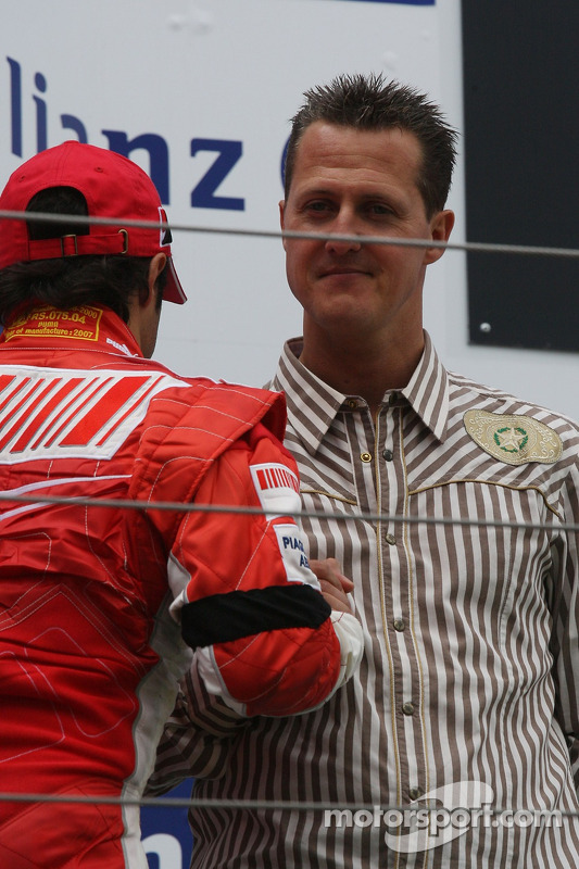 2. Felipe Massa, Ferrair, mit Michael Schumacher
