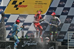 Podium: race winner Casey Stoner with Chris Vermeulen and Marco Melandri