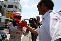 Pole winner Timo Scheider celebrates