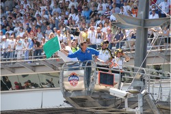 Actor and Allstate 400 at the Brickyard Grand Marshall James Denton waves the green flag to start the race