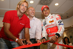 Lewis Hamilton, McLaren Mercedes, with Tamas Kasas, water polo player cutting the ribbon to open the new Vodafone shop