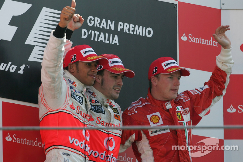 Podium: race winner Fernando Alonso and Lewis Hamilton and Kimi Raikkonen