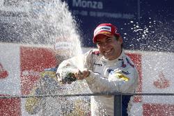 Timo Glock celebrates victory on the podium