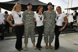 Members of the armed forces pose with lovely Playboy bunnies
