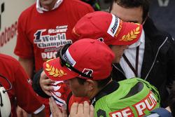 2007 MotoGP champion Casey Stoner celebrates with Randy De Puniet