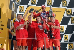 Podium: 2007 MotoGP champion Casey Stoner celebrates with his team