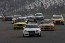 The pace car leads the field to a race restart after a 5-hour interruption
