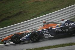 Adrian Sutil, Spyker F1 Team, F8-VII and Nico Rosberg, WilliamsF1 Team, FW29