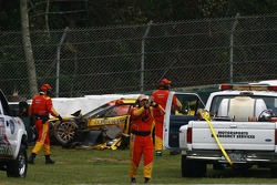 Safety team to the rescue after the crash of the #3 Corvette Racing Corvette C6-R of Jan Magnussen
