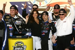 Victory lane: race winner Jeff Gordon celebrates with wife Ingrid and Rick Hendrick