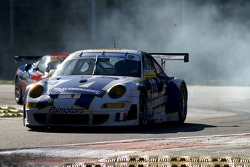 Something happening in the back of #74 Ebimotors Porsche 997 GT3 RSR…