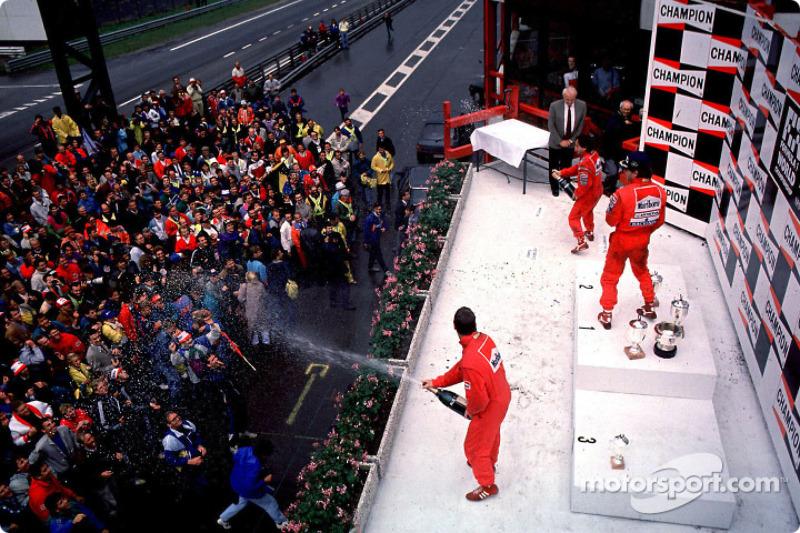 Podium: race winner Ayrton Senna with Alain Prost and Nigel Mansell