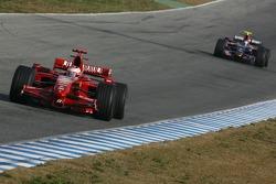 Kimi Raikkonen, Scuderia Ferrari, F2007 and Sebastian Vettel, Scuderia Toro Rosso, STR02
