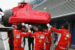 Michael Schumacher, Test Driver, Scuderia Ferrari, car is returned to the pits after spinning in the gravel
