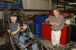 Robert Hight, in cockpit, gives physical therapist Robert  Ortmayer a quick primer on driving a Funny Car so that he has a better  understanding of how much more work will be needed to get John Force back in a  race car by mid-January