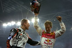 Race of Champions winner Mattias Ekström celebrates with second place Michael Schumacher