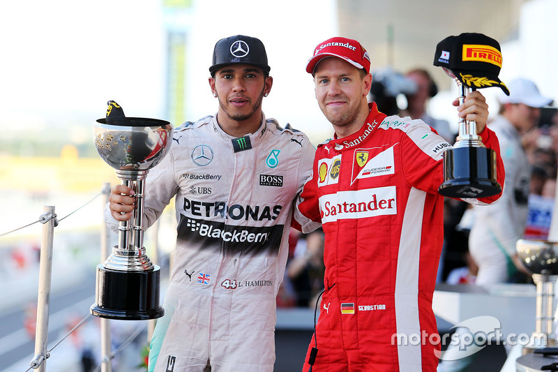 Race winner Lewis Hamilton, Mercedes AMG F1 celebrates on the podium with third placed Sebastian Vettel, Ferrari