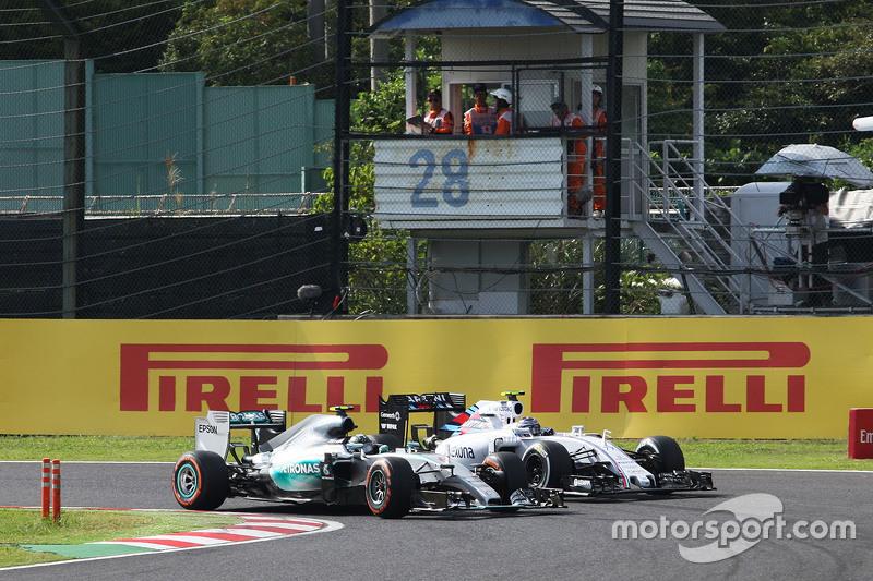 Ніко Росберг, Mercedes AMG F1 W06 та Валттері Боттас, Williams FW37 - боротьба за позиції