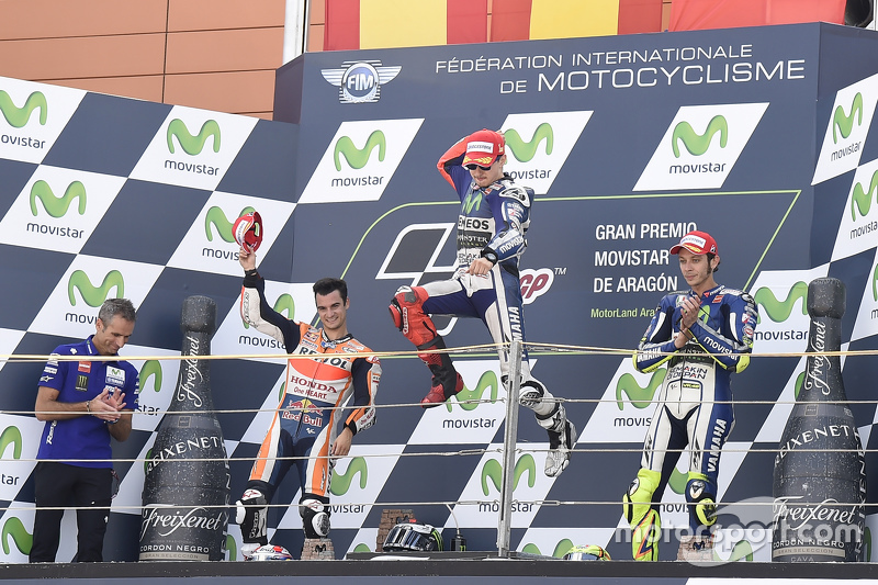 Podium: second place Dani Pedrosa, Repsol Honda Team and winner Jorge Lorenzo and third place Valentino Rossi, Yamaha Factory Racing