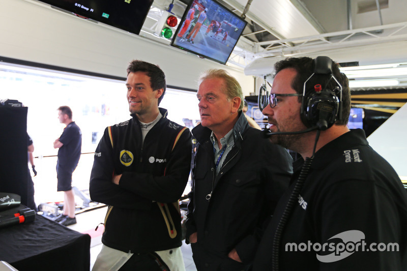 (L to R): Jolyon Palmer, Lotus F1 Team Test and Reserve Driver with father Jonathan Palmer, and Julien Simon-Chautemps, Lotus F1 Team Race Engineer