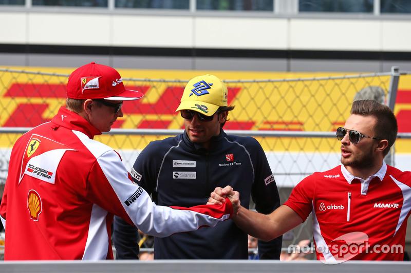 (L to R): Kimi Raikkonen, Ferrari with Felipe Nasr, Sauber F1 Team and Will Stevens, Manor F1 Team on the drivers parade