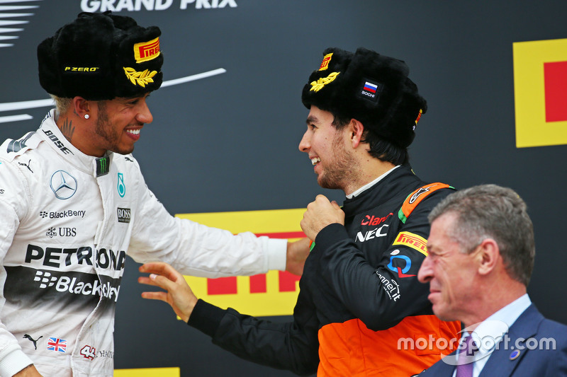 (L to R): Race winner Lewis Hamilton, Mercedes AMG F1 celebrates on the podium with third placed Sergio Perez, Sahara Force India F1