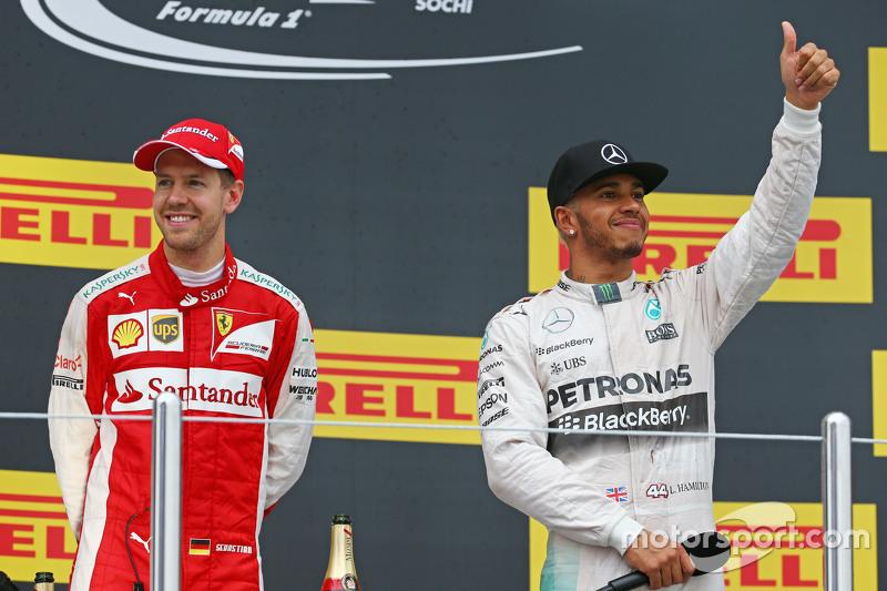 (L to R): second placed Sebastian Vettel, Ferrari with race winner Lewis Hamilton, Mercedes AMG F1 o