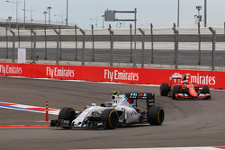 Valtteri Bottas, Williams FW37 leads Kimi Raikkonen, Ferrari SF15-T