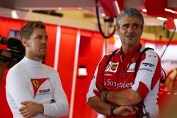 (L to R): Sebastian Vettel, Ferrari with Maurizio Arrivabene, Ferrari Team Principal
