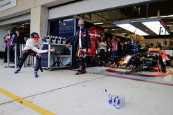 (L to R): Max Verstappen, Scuderia Toro Rosso and team mate Carlos Sainz Jr., Scuderia Toro Rosso practice their bowling in the pits