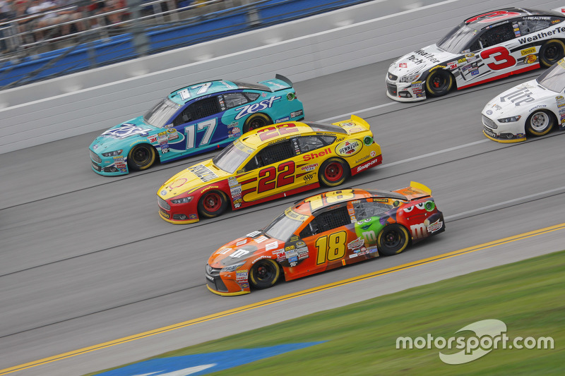 Kyle Busch, Joe Gibbs Racing Toyota and Joey Logano, Team Penske Ford and Ricky Stenhouse Jr., Roush Fenway Racing Ford