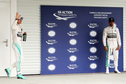 Polesitter Nico Rosberg, Mercedes AMG F1 in parc ferme with second place team mate Lewis Hamilton, M
