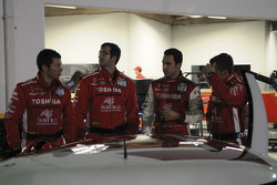 Helio Castroneves with Penske-Taylor Racing team members