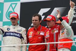 Podium: race winner Kimi Raikkonen, second place Robert Kubica, third place Heikki Kovalainen, Stefano Domenicali, Scuderia Ferrari, Sporting Director