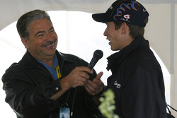 Colin Braun talks with Joe Moore in the Con-Way hospitality tent