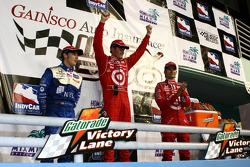 Podium: race winner Scott Dixon celebrates with Marco Andretti and Dan Wheldon