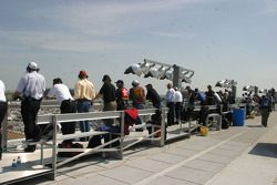 Spotters watch from the roof